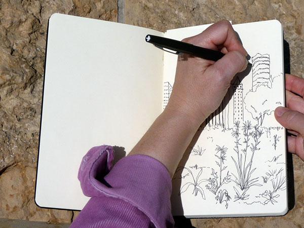 Someone sketching Stock Photos - Page 1 : Masterfile